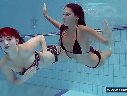 Katrin and Lucy yam-sized tits underwater
